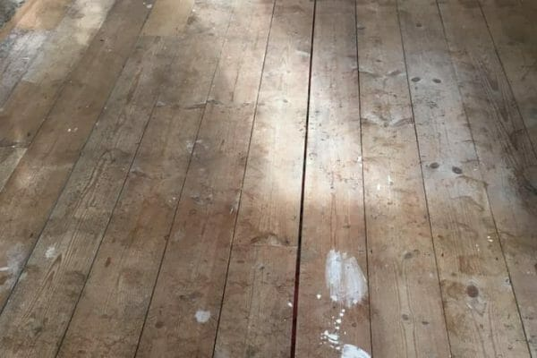 pine floorboards before restoration